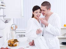 Happy lovers having breakfast Stock Photography