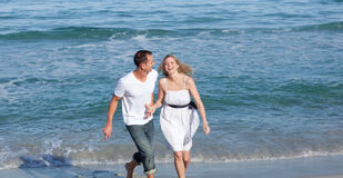 Happy lovers having fun at the seaside Royalty Free Stock Images