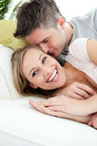 Happy lovers having fun together on a sofa Royalty Free Stock Images