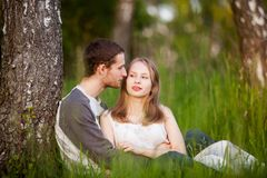 Happy lovers hugging in the birch grove stock image