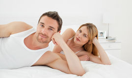 Happy lovers looking at the camera Stock Photography