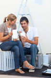 Happy Lovers relaxing while renovating. Their new house Royalty Free Stock Images