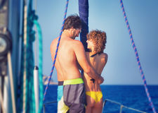 Happy lovers on sailboat Stock Images