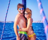 Happy lovers on sailboat Royalty Free Stock Photo
