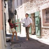Happy lovers in a street. A happy young couple standing in a lane with naked foots Stock Photo