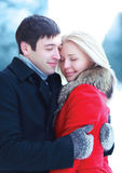 Happy lovers young couple hugging in winter Royalty Free Stock Image
