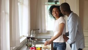 Happy african young couple celebrate anniversary prepare healthy vegetable salad