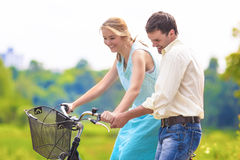 Happy Loving Caucasian Couple Having Fun Together Riding Bike Ou Stock Photography