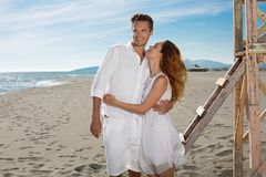 Happy loving couple on a beach Royalty Free Stock Images
