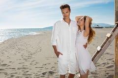 Happy loving couple on a beach Stock Photos