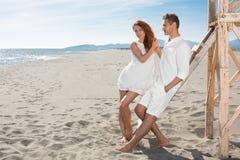 Happy loving couple on a beach Stock Photography