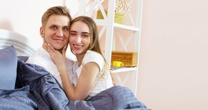 Happy loving couple in the bedroom in morning Copy space . Family couple people concept.  royalty free stock photos