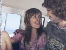 Happy Loving Couple In Campervan Stock Photos
