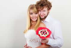 Happy couple with candy bunch flowers. Love. Royalty Free Stock Photo