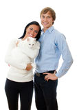 Happy loving couple with cat. Royalty Free Stock Photos
