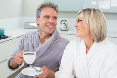Happy loving couple with coffee cup in kitchen Royalty Free Stock Photo