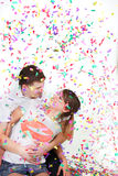 Happy loving couple in confetti Stock Photo