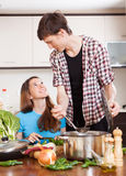 Happy loving couple cooking together Royalty Free Stock Photo
