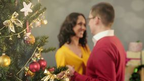 Happy loving couple dancing at Christmas party, togetherness, magic moments royalty free stock images