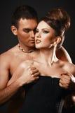Happy loving couple. Dark background. Royalty Free Stock Photography