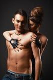 Happy loving couple. Dark background. Stock Image