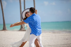 Happy loving couple embracing and dancing outdoors at summertime Royalty Free Stock Photo