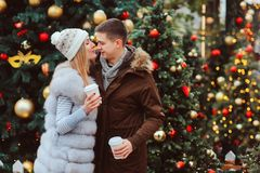 Happy loving couple enjoying Christmas or New year Holidays outdoor royalty free stock photography