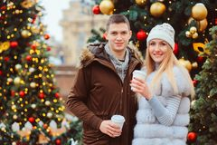 Happy loving couple enjoying Christmas or New year Holidays outdoor royalty free stock photos