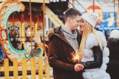 Happy loving couple enjoying Christmas or New year Holidays outdoor stock image