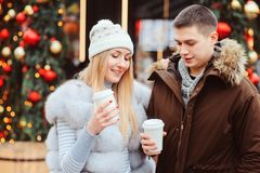Happy loving couple enjoying Christmas or New year Holidays outdoor stock images