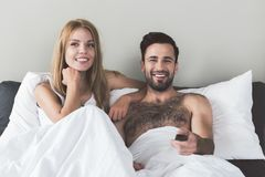 Happy loving couple entertaining in bedroom Royalty Free Stock Photos