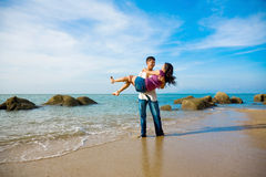Happy loving couple having fun at the beach Royalty Free Stock Images