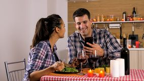 Happy loving couple is having romantic dinner at home. royalty free stock photography