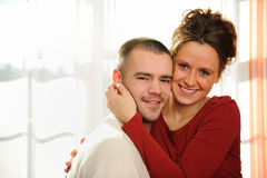 Happy loving couple at home Royalty Free Stock Images