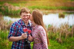 Happy loving couple are kissing near the Lake Stock Photos