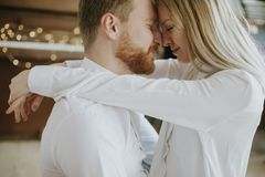 Loving couple kissing in the room. Happy and loving couple kissing in the room Royalty Free Stock Photos
