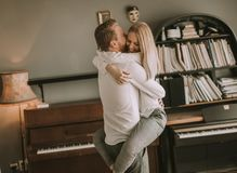 Loving couple kissing in the room. Happy and loving couple kissing in the room Stock Images