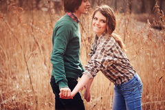 Free Happy Loving Couple On The Walk In Early Spring Field Royalty Free Stock Photos - 54609518