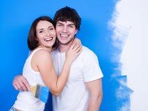 Happy loving couple of painters stock photo