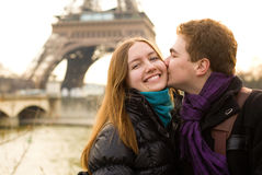 Happy loving couple in Paris. Kissing by the Eiffel Tower Stock Photography