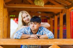 Happy loving couple. Portrait of beautiful young couple bonding to each other and smiling while both standing outdoors.  Royalty Free Stock Images