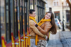 Happy loving couple posing near a tram in the city Lviv Stock Photos