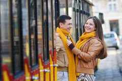 Happy loving couple posing near a tram in the city Lviv Stock Image