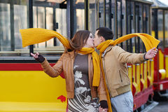 Happy loving couple posing near a tram in the city Lviv Royalty Free Stock Photo