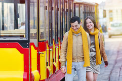 Happy loving couple posing near a tram in the city Lviv Stock Photography