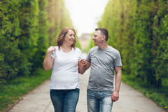 Happy loving couple on a romantic walk outdoors in park Stock Photos