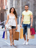 Happy loving couple with shopping bags at city Royalty Free Stock Images