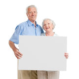 Happy loving couple with sign stock photos