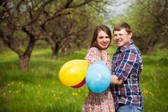 Happy loving couple on a spring meadow Stock Images