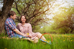 Happy loving couple on a spring meadow Royalty Free Stock Photos